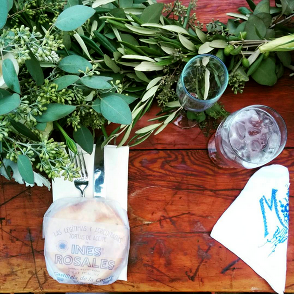 Simple olive branch centerpieces