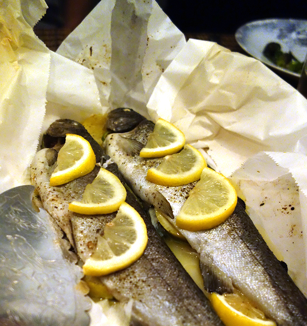 trout in paper with lemon