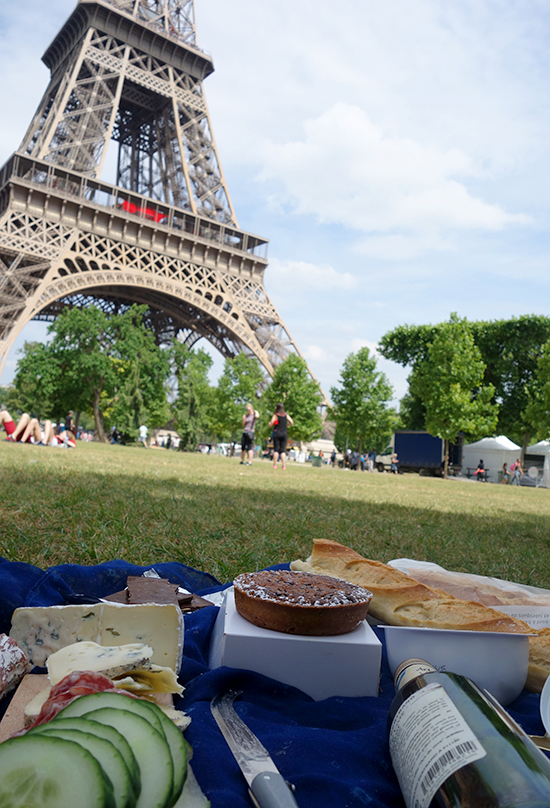 Eating a baguette, cheese and pastry at the Champs de Mars in Paris