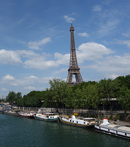 Boats in the Seine River and the Eiffel Tower while walking back from the 16th