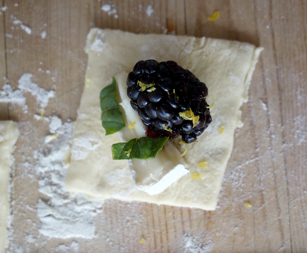 Filling puff pastry with basil and cheese