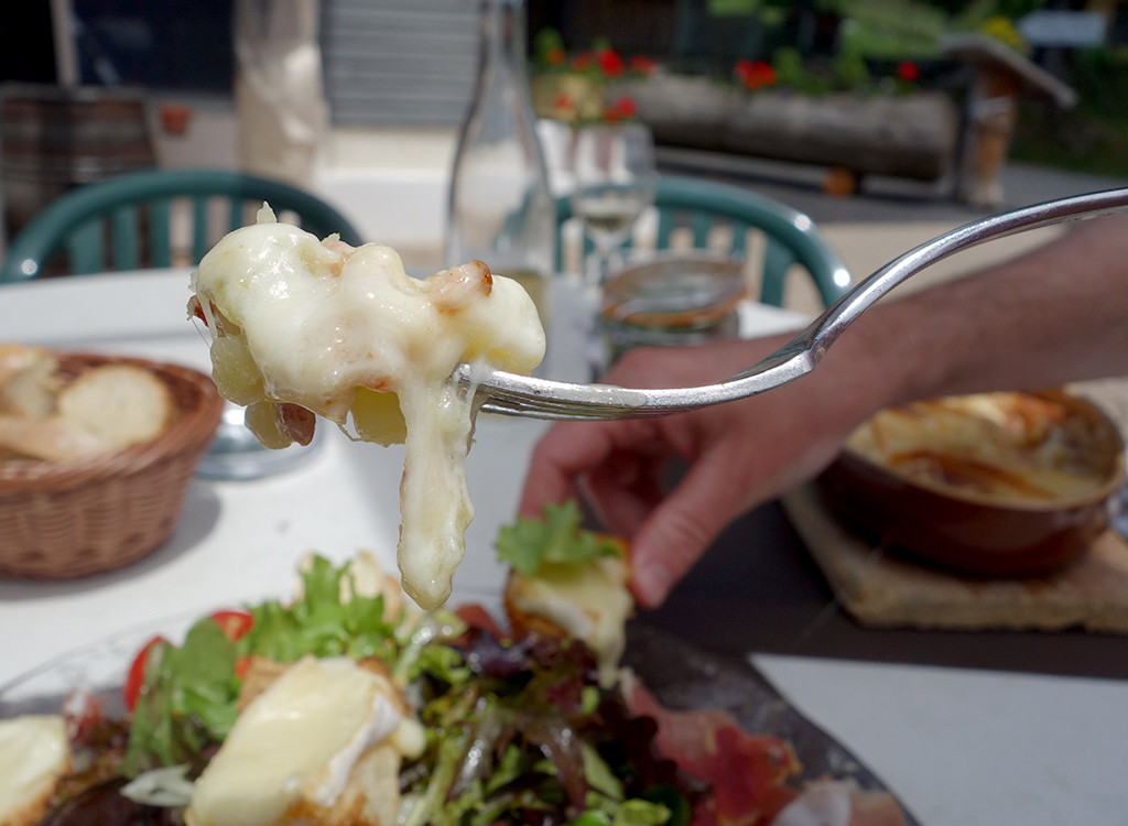 Forkful of tartiflette in Montmin, France